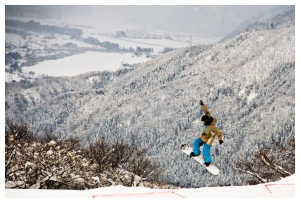 Snowboarder jumping in Ishikawa, Japan