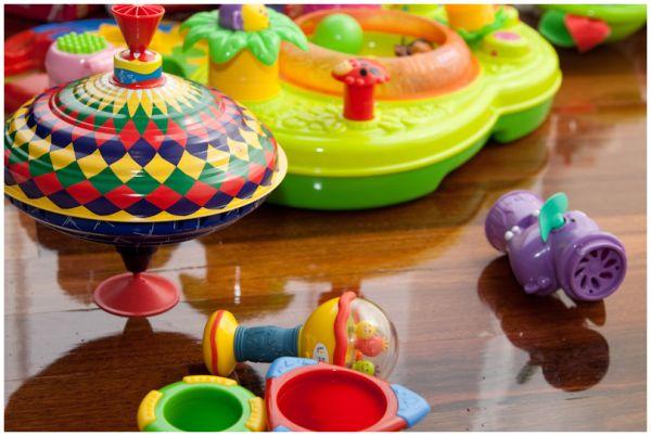 colourful children's toys scattered on floor