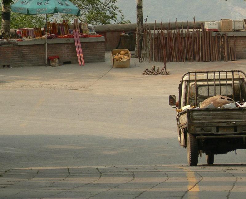 A truck drifts away from Jie Tai Temple