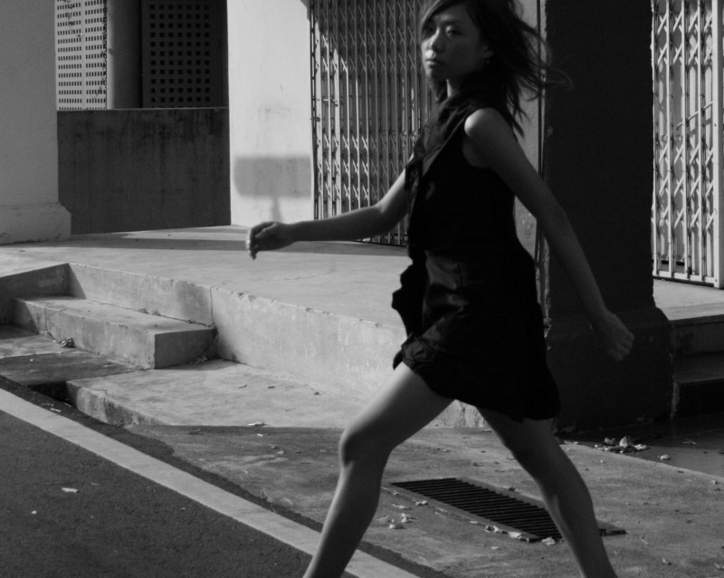 beautiful girl model crossing the road energy move