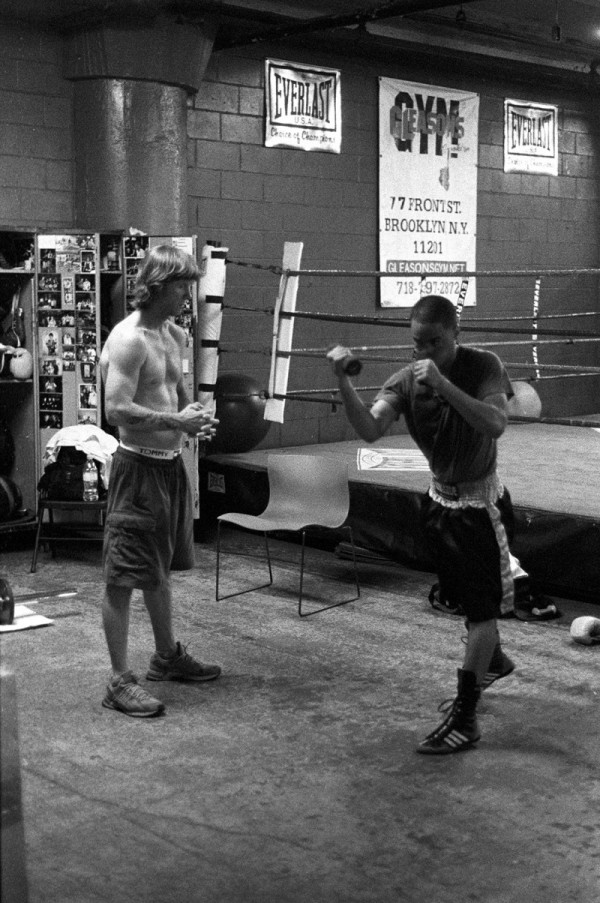 Boxing Coach Mike working with another student