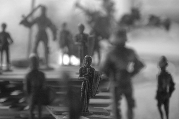 close-up of pewter soldiers on wooden stageon