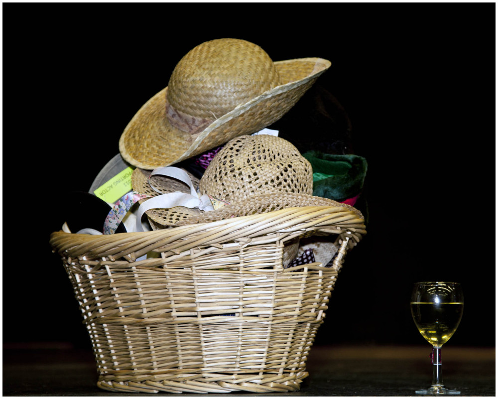 A Basket of Hats and a Glass of Wine