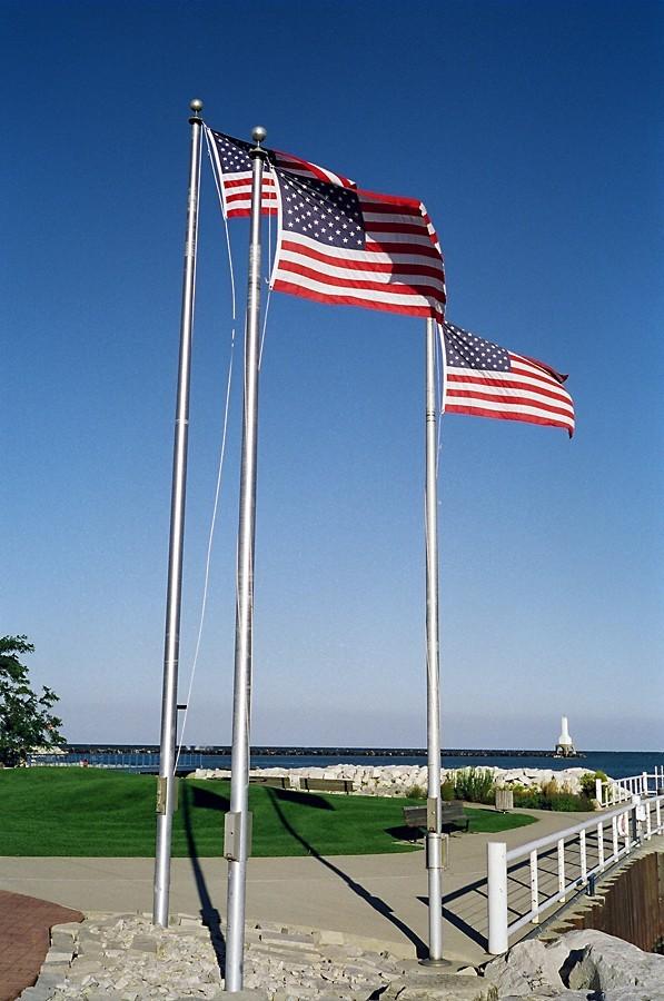 three flags along the lakeshore