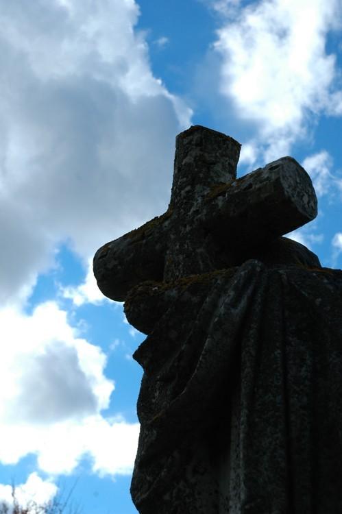 gravestone statue against the sky