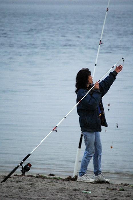 woman adjusting fishing poles