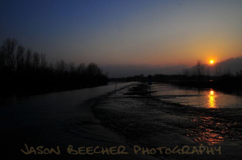 Sun setting on the flood