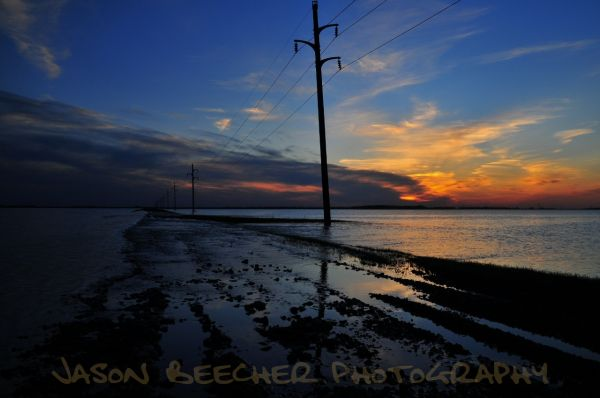 Last nights sunset over a flooded county road.