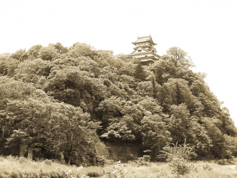 A sepia image of Inuyama Castle in Japan
