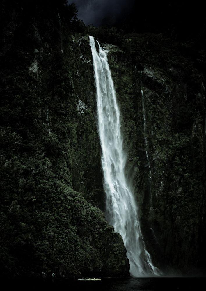 kayaking below milford sound waterfall