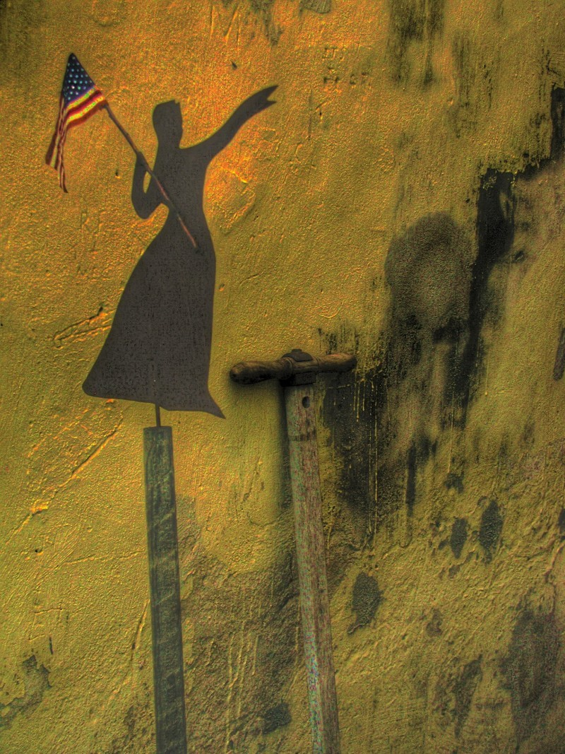Cutout of woman and flag