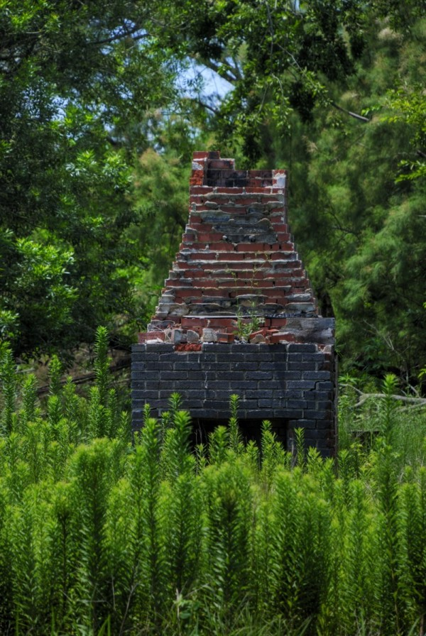 A chimney stands alone