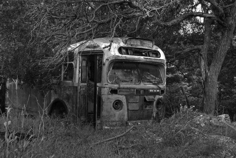 Abandoned bus in field on highway to Waco