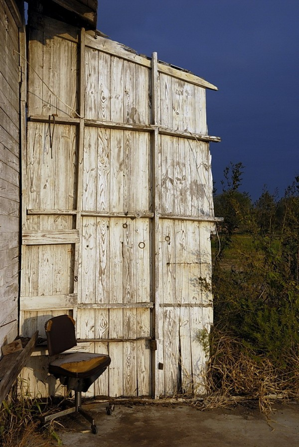 Abandoned building and chair, Nixon, Texas