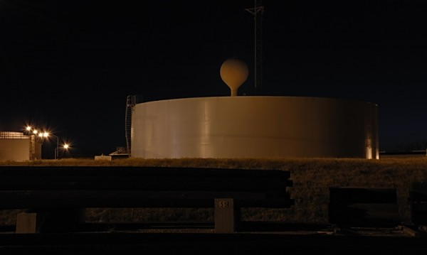 Storage tank and water tower from pole yard, Raybu
