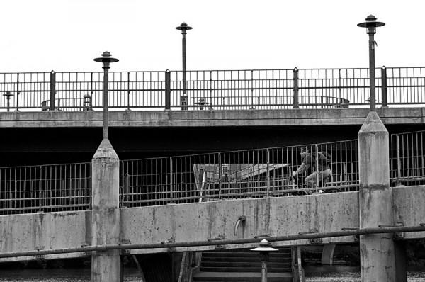 Bike rider on Lamar Street pedestrian bridge