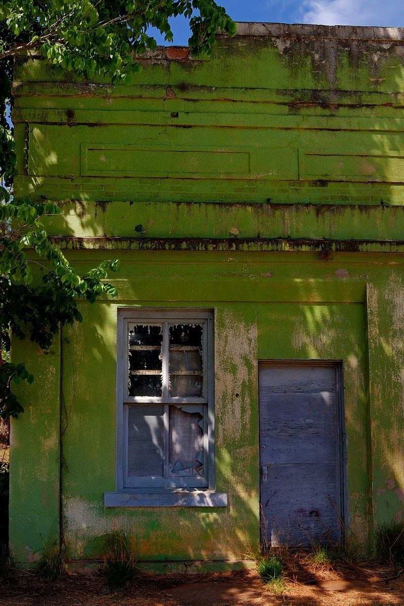 Building with lime green facade, Cuero, Texas
