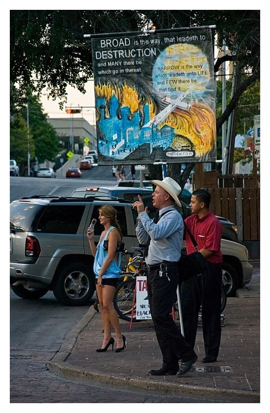 Street preacher and leggy pedestrian, 6th Street