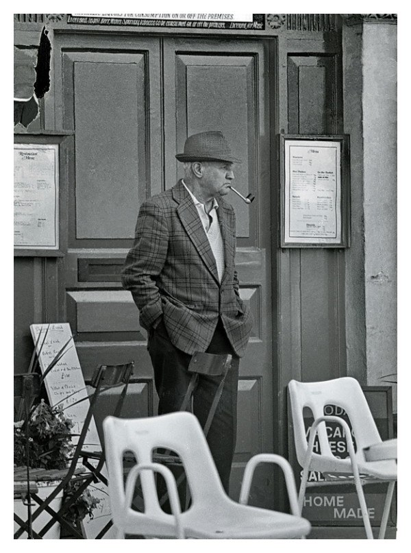 English Gentleman smoking pipe in front of pub