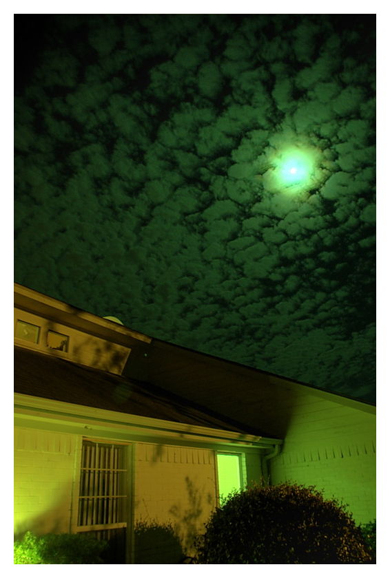 Moon and clouds over suburbia