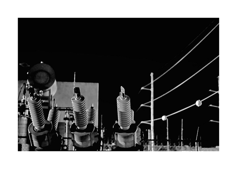 Insulators, power plant, night