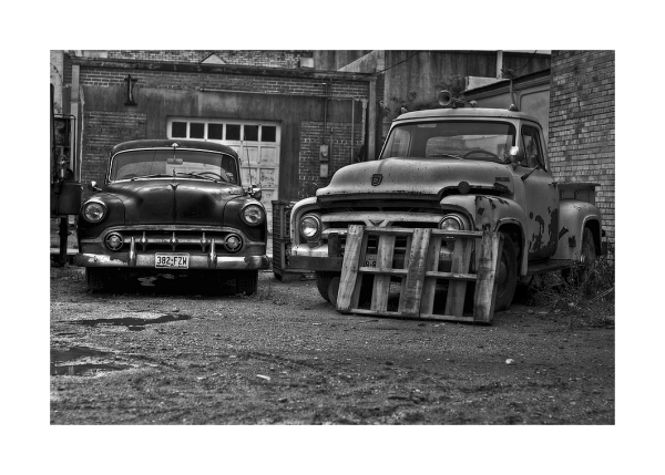 Cars in alley, Yoakum, Texas
