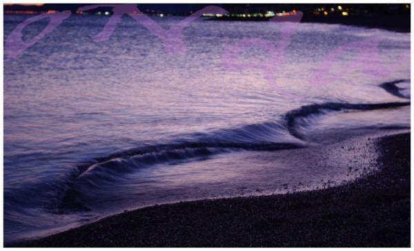 waves on a violet suset