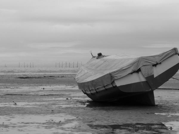 Fishing boat on sand