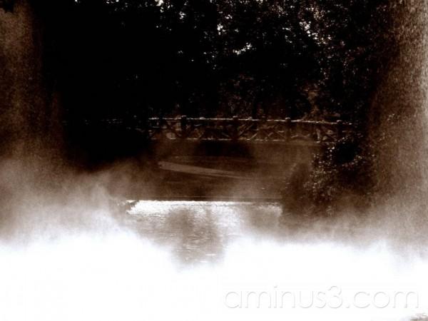 Bridge in misty water spray