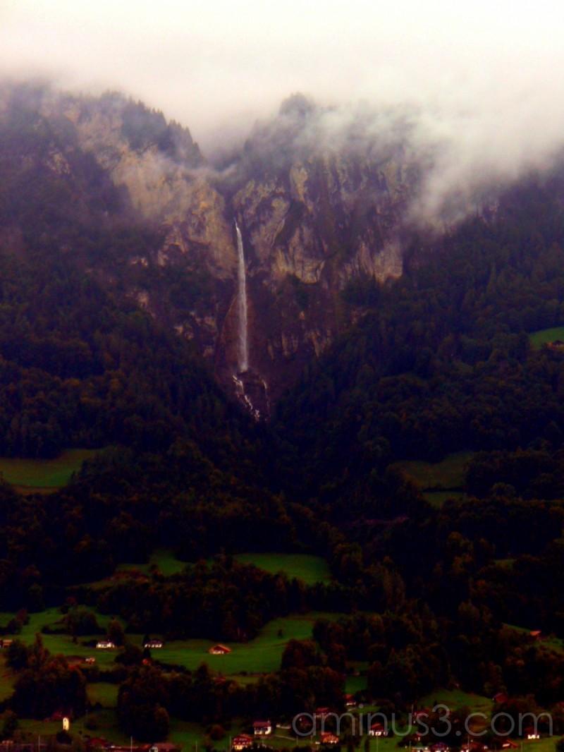 Waterfall over village Lake Brienz Switzerland