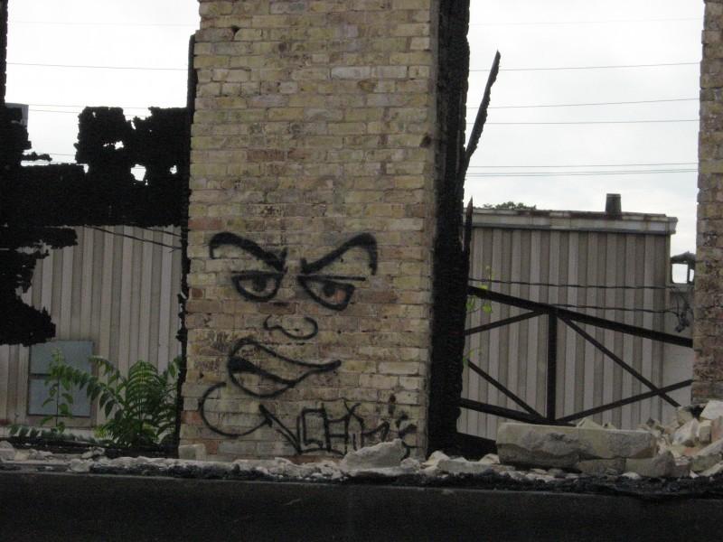 brick rubble face graffitti