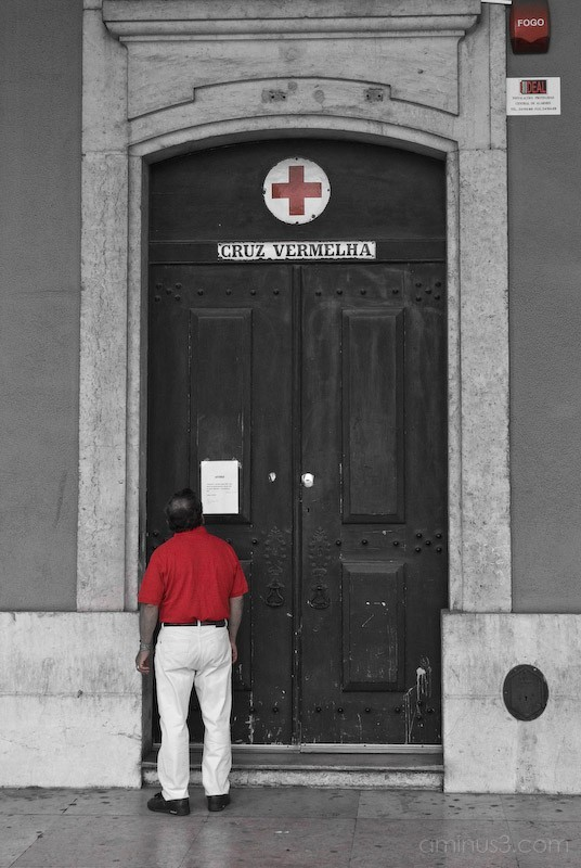 A red person at the red cross