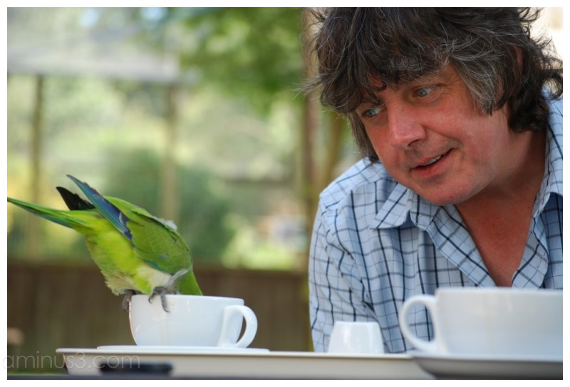 Ian and a coffee loving bird.
