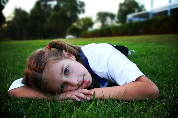 Child laying on the grass
