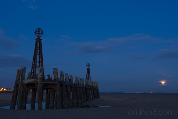 Moon rise over old pier