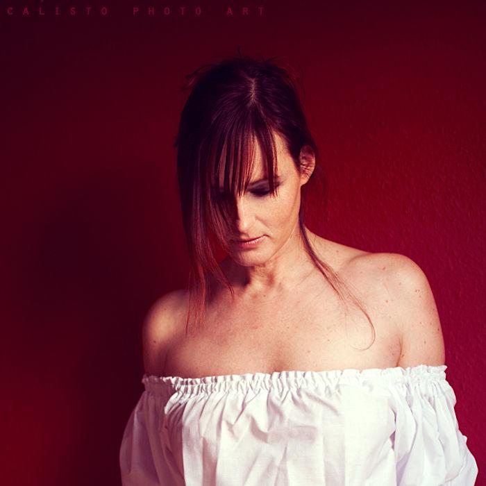 square, portraiture, female, lie, emotive, red