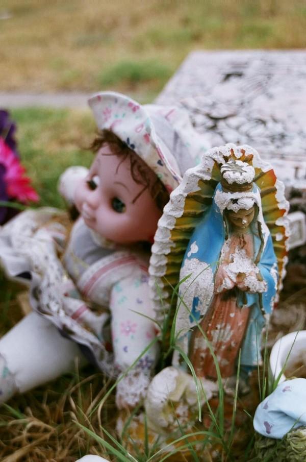 Doll, Virgin, & Gravestone