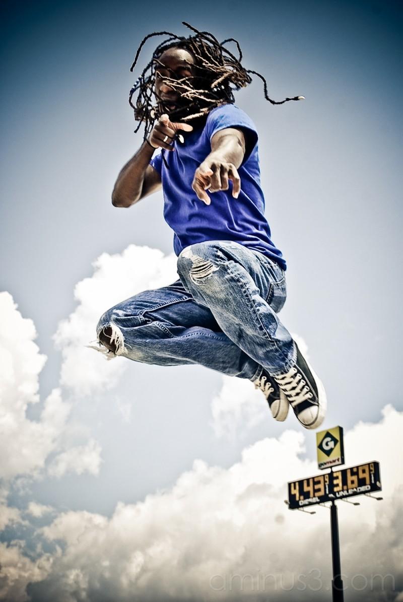 Blue man jumps