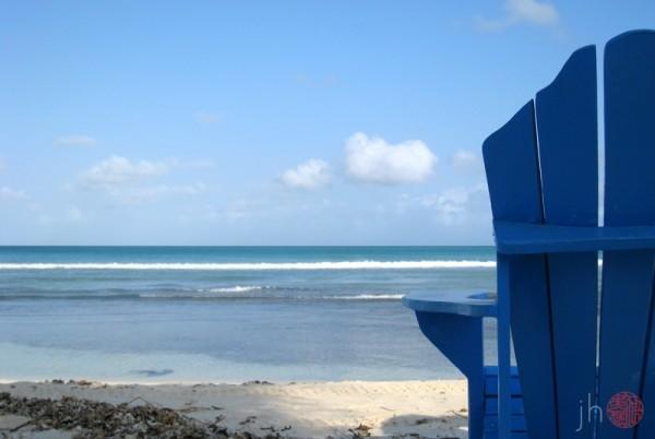 behind the blue chair