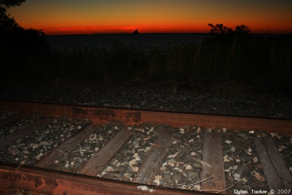 Railroad tracks and sunset over lake ontario