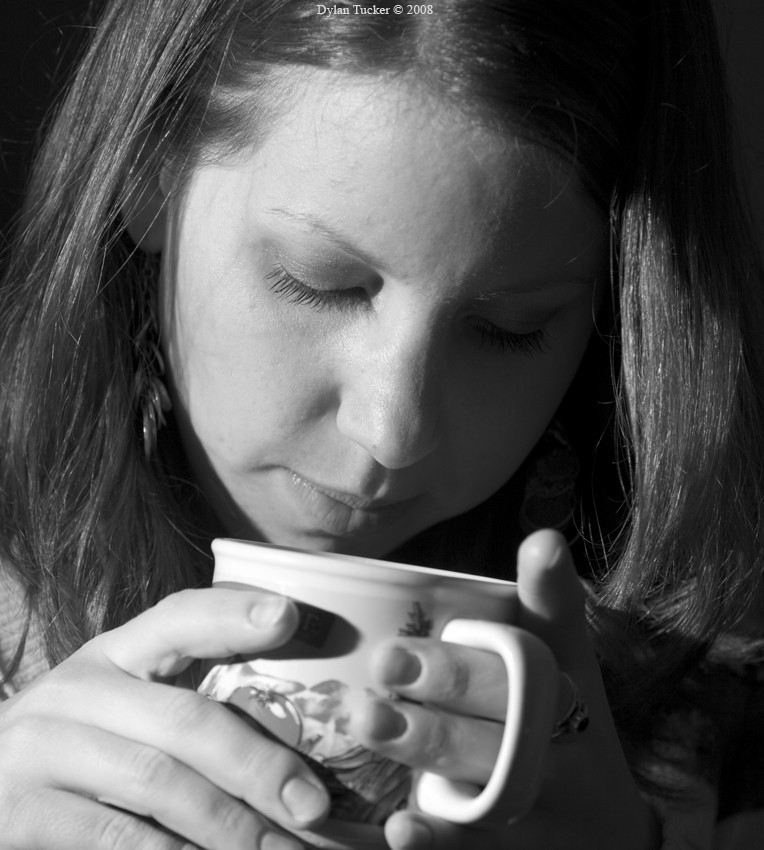 girl holding a cup of warm tea