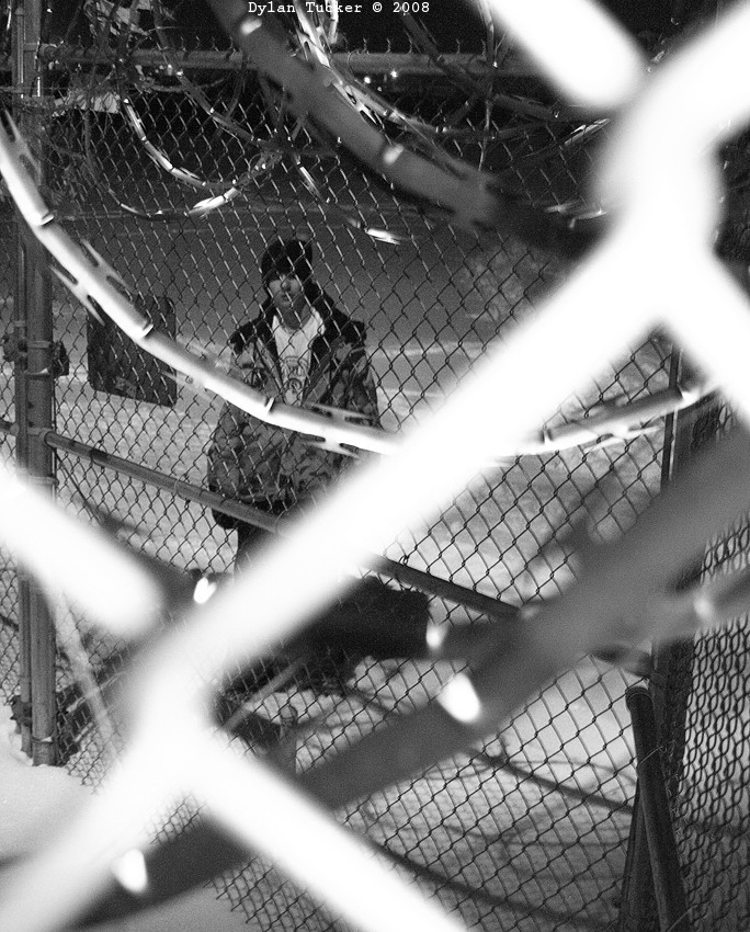 looking at a person through razor wire
