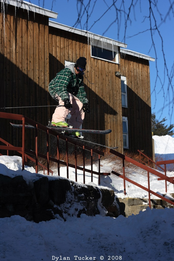 Sliding a rail on skis