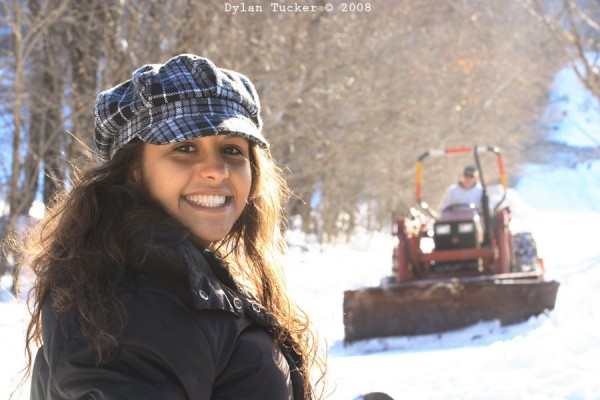 girl smiling on a sunny day in the snow
