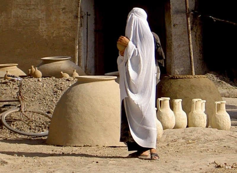 Aqghan woman buying pottery