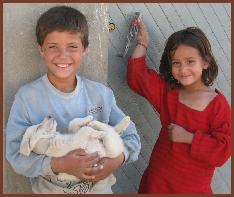 afghan boy with a puppy