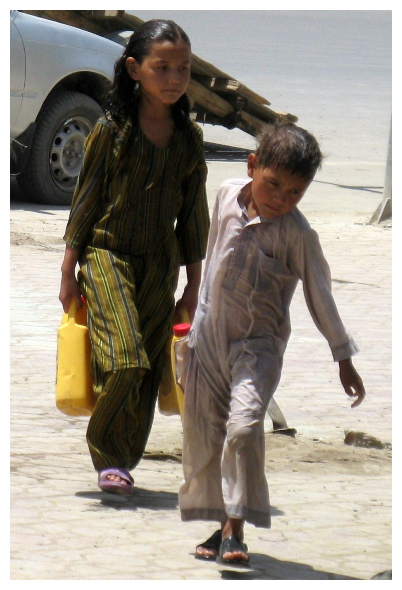 afghan children carrying water