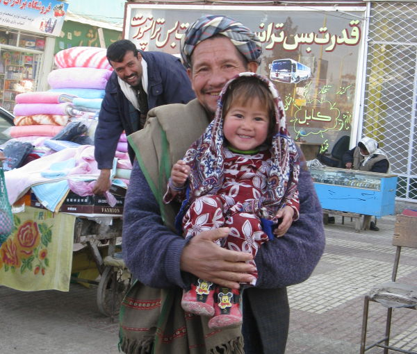Afghan father and daughter smiling
