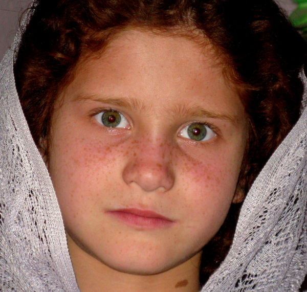 young afghan girl with red hair