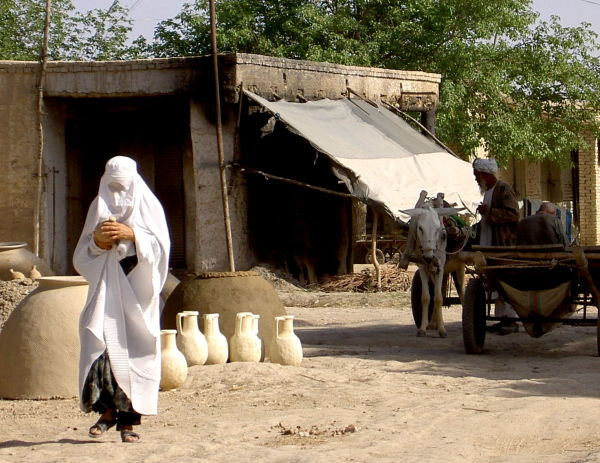 woman in white burqah at the potters' in Aqcha